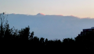 Rising sun on cloud bank