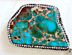 Turquoise pendant with marcasite surround.